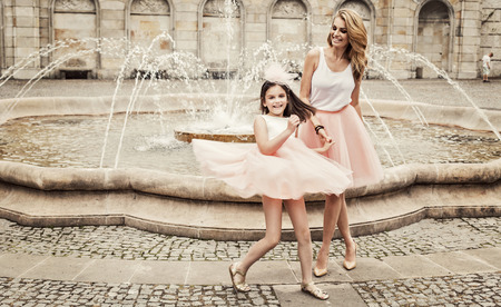 Mother and daughter having fun in same outfits weared tutu skirts Archivio Fotografico