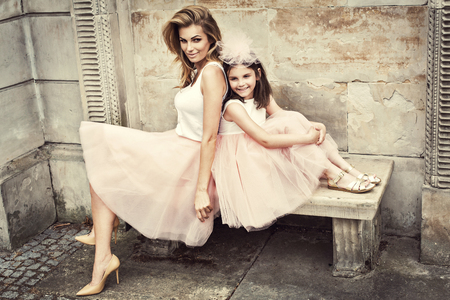 parents  love: Mother and daughter in same outfits weared tutu skirts