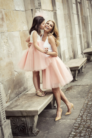 hot pink: Mother and daughter in same outfits weared tutu skirts