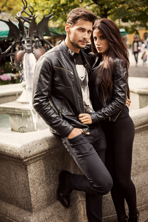 man woman hugging: Portrait of attractive couple in leather jacket. Autumn photo