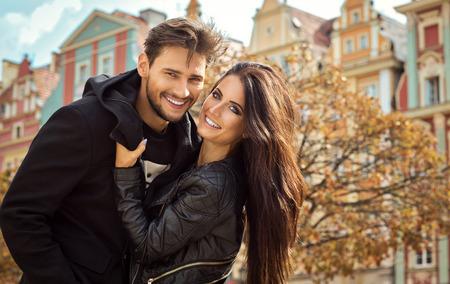 Beautiful happy couple in autumn scenery Stock Photo