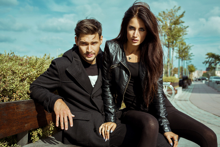 Sexy couple in jacket in autumn scenery photo