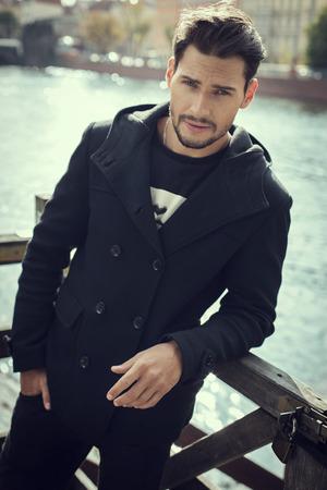 Handsome man in coat photo