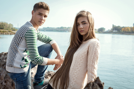 Portrait of attractive girl with long hair and handsome boy posing each other