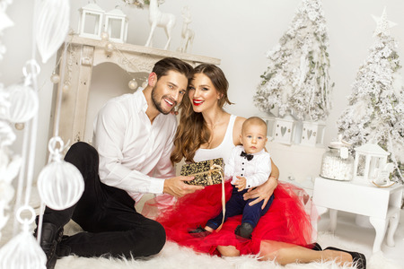 happy christmas: Happy father giving a Christmas present to his wife. Happy Familly in Christmas Time Stock Photo