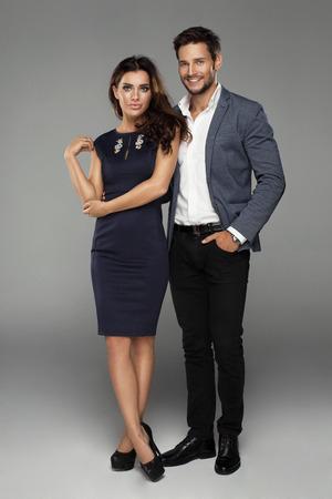 Beautiful couple on grey background