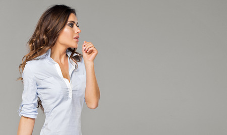 woman white shirt: Portrait of brunette woman looking on a empty space