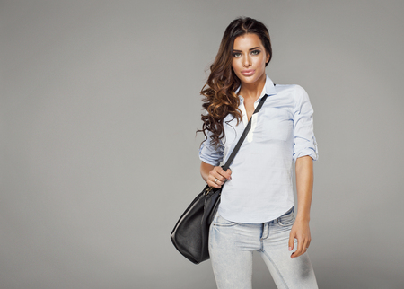 sexy fashion: Beautiful happy woman holding a bag