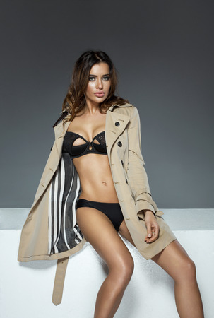 undressed woman: Undressed woman in coat Stock Photo