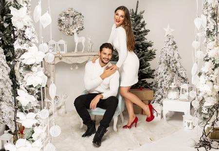 christmas scenery: Beautiful happy couple in Christmas scenery