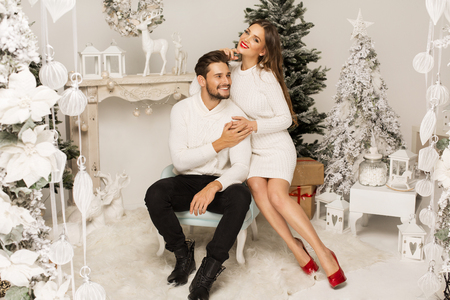 Beautiful happy couple in Christmas scenery