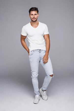 males: Handsome man wearing jeans and white t-shirt Stock Photo