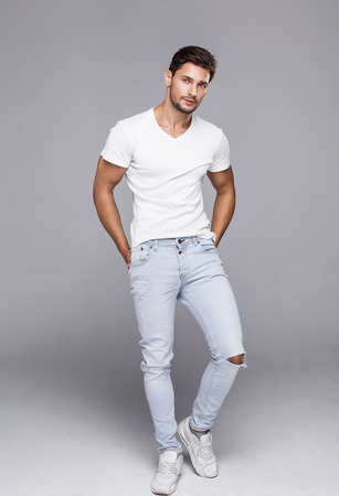 hand free: Sexy handsome man in white t-shirt looking at camera Stock Photo