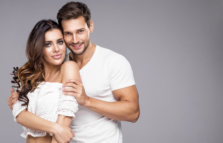 Portrait of beutiful young couple smiling photo