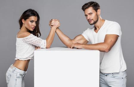 Beautiful couple doing arm wrestling challenge photo