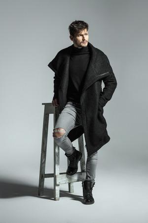 Handsome model in black long coat