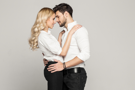 two sexy women: Young couple looking at each other Stock Photo