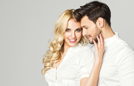Portrait of blond smiling woman with white teeth and handsome man 版權商用圖片