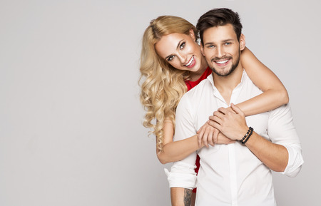 clothing model: Portrait of smiling beautiful couple