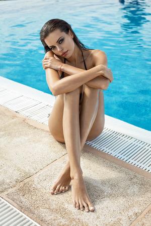 wet women: Sexy model wearing bikini by the pool