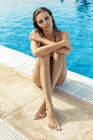 sexy model: Sexy model wearing bikini by the pool