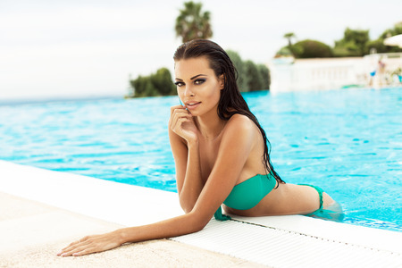 beauty breast: Sexy model in the pool Stock Photo