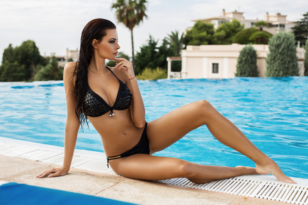 beautiful woman body: Beautiful woman with sexy body by the pool