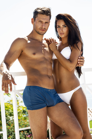 Sexy couple posing in swimsuit
