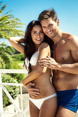 to undress: Happy couple wearing swimsuit and enjoy the summer time