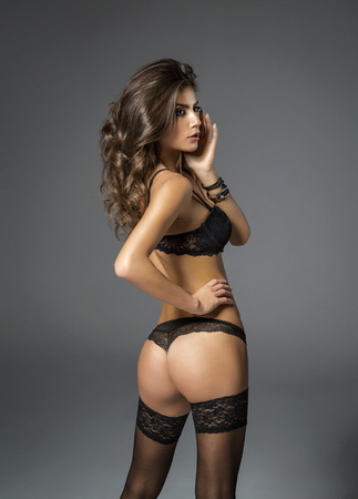 sexy women naked: Beauty brunette woman with attractive buttocks in lace lingerie. Female ass in underwear Stock Photo