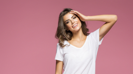 spa woman: Portrait of a smilling brunette woman touching her forehead Stock Photo