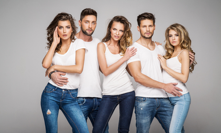 Group of young models posing Stock Photo