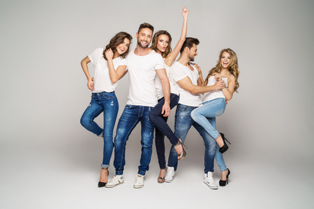 Group of young beautiful people smiling and having fun together