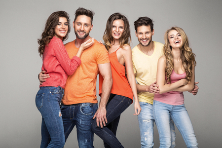 young happy couple: Group of smiling friends wear fashionable colorfull clothes Stock Photo