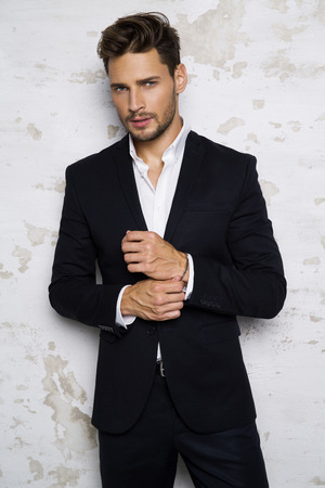 Portrait of sexy man in black suit Imagens - 61823818