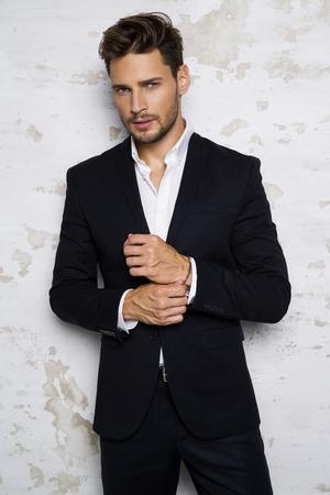 Portrait of sexy man in black suit