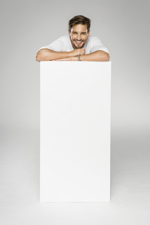 empty space: Handsome man with empty space for advert Stock Photo