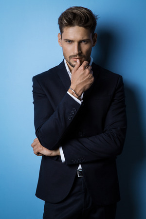 studio portrait: Handsome man wear black suit