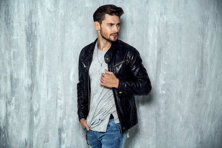 Photo of handsome man in black leather jacket