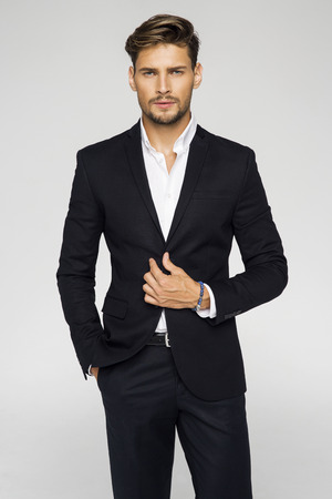 Portrait of handsome man in black suit Standard-Bild