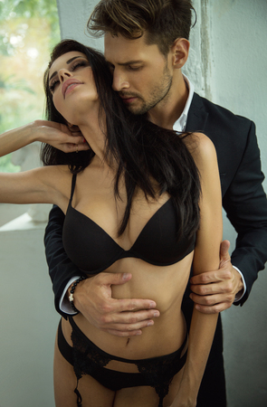 Sensual couple touching at each other Stockfoto
