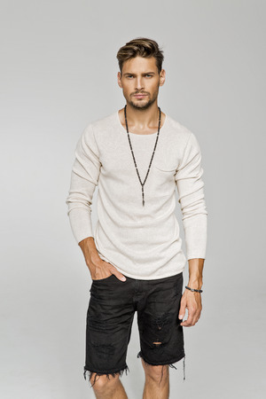 Sexy man wear men's jewelry and black shorts