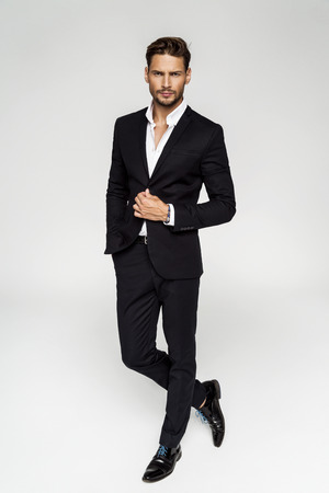 Portrait of handsome man in black suit Stock Photo