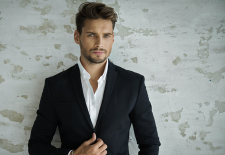 Portrait of sexy man in black suit Imagens - 62133541