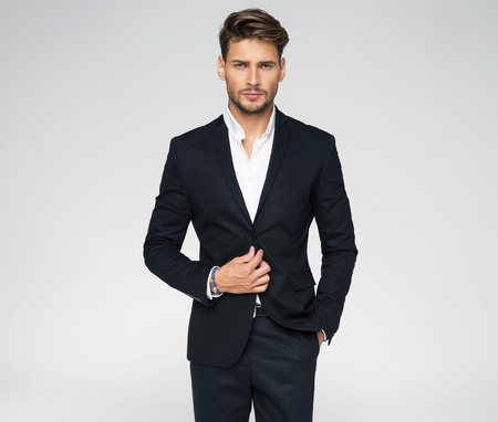 Portrait of handsome man in black suit Stock fotó