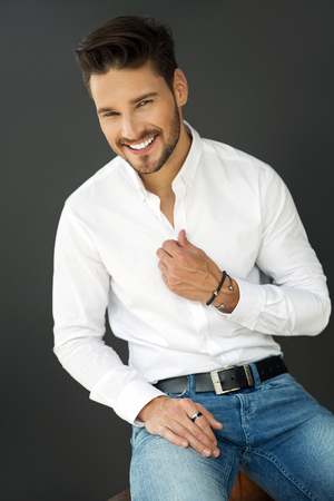 Portrait of smiling man in white shirt