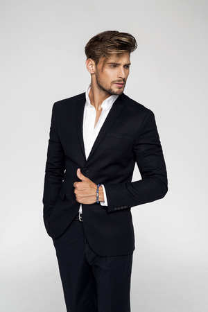 Portrait of handsome man in black suit Foto de archivo