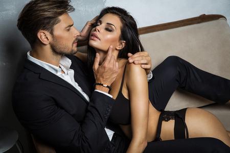 Sexy couple on coach