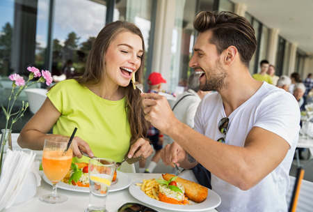 Beautiful couple on lunch at restaurant Stock Photo