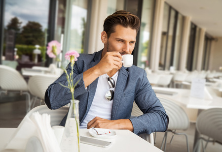 casual fashion: Portrait of handsome man drinking coffee Stock Photo